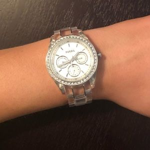 Woman's clear Fossil watch